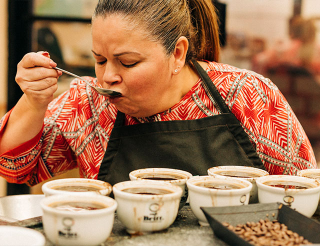 Woman cupping Cafe Britt coffee